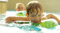 Happy little boy swimming with rubber ring in the  Footage