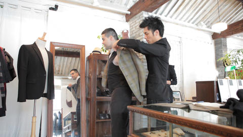Foreigner Buying Custom-Made Suit In Chinese Shop stock footage