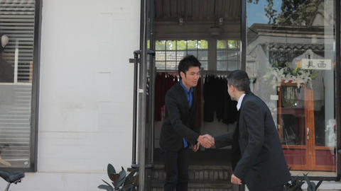Young Chinese Businessman Opens Shop Stock Video Footage