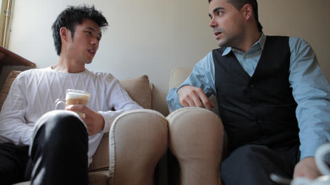 Young Chinese And Italian Men Friends Chatting stock footage