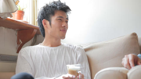 Young Handsome Chinese Man Chatting With A Friend stock footage