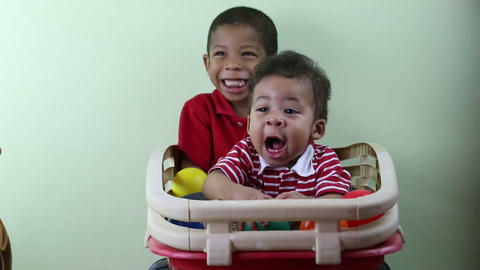 Brothers playing indoors Stock Video Footage
