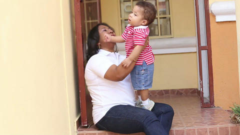 African mother with her baby having fun together Footage