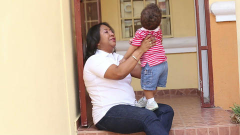 African mother with her baby having fun together Stock Video Footage