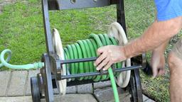 Winding up hose reel Footage