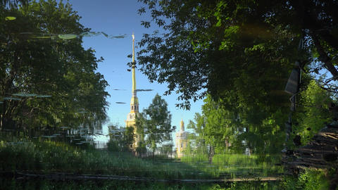 The spire of the Peter and Paul fortress is reflec Stock Video Footage