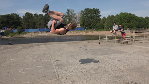 The young man doing somersaults. Salto. 4K Footage