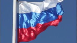 Russian state flag is fluttering in the blue sky Footage