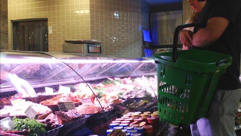 Couple buying fresh shrimp Live Action