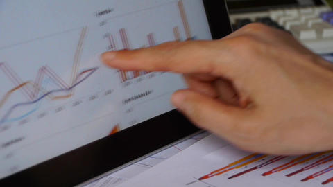 Businessman working on tablet with diagrams,finger Footage