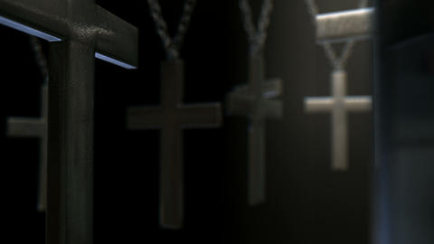 hanging crucifixes and chains spotlight pan Stock Video Footage
