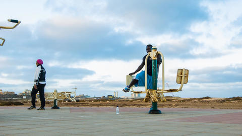 dolly shot of a man working out on Cape Verde Stock Video Footage