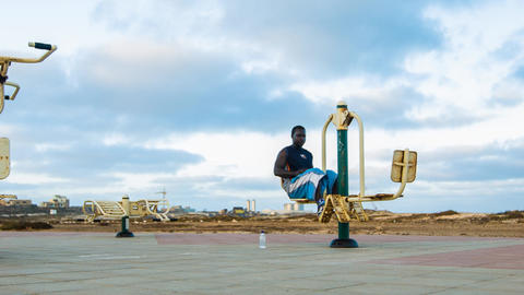 dolly shot of a man working out on Cape Verde Footage