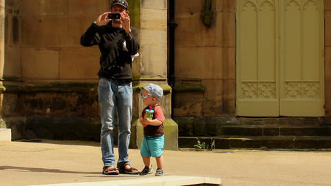Father taking photos with a son Stock Video Footage