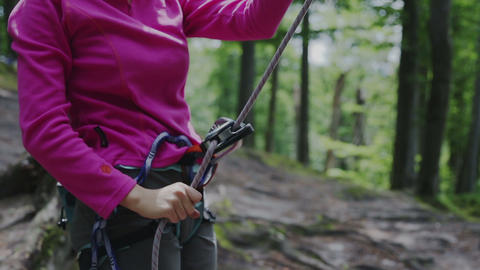 Female Belayer With The Rope And Carabines stock footage
