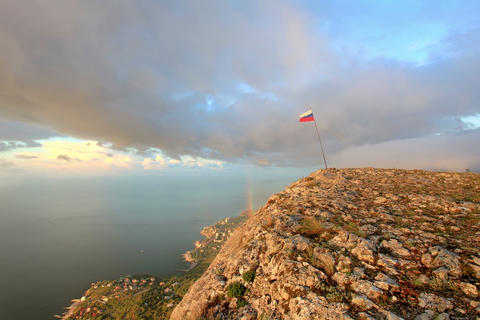 4K. Russian flag on the top of a mountain on the b Footage