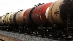 Freight train with tank cars passing by Footage