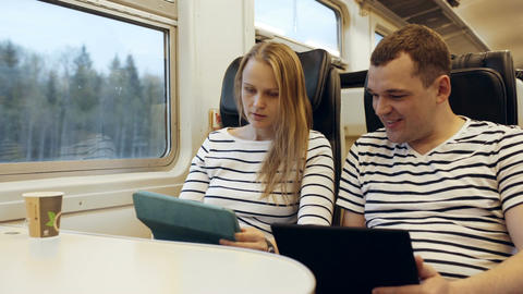 Young people talking in the train looking on the t Footage