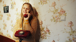 Happy Young Woman Receving A Call At Home stock footage