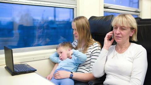 Passengers in the train watching video on laptop a Footage