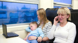 Passengers in the train watching video on laptop a Stock Video Footage