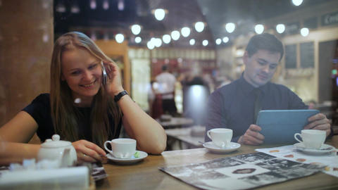 Young people in a cafe with phone and tablet pc Stock Video Footage