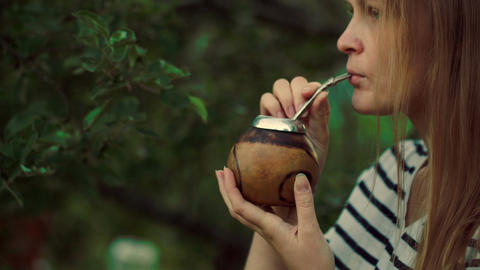 Young woman drinking mate outdoor Footage