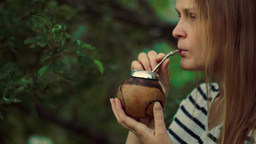 Young woman drinking mate outdoor Stock Video Footage
