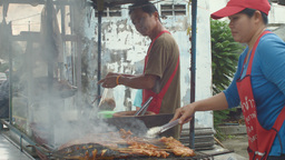 Thai Street Food Vendors Selling Som Tum and Grill Stock Video Footage