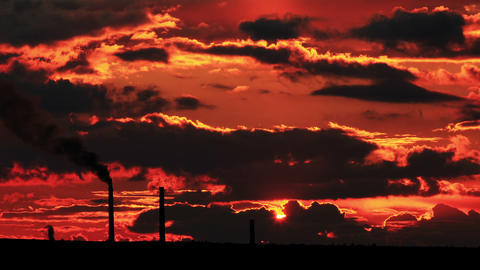 Factory pipe polluting air at sunset. environmenta Footage
