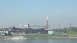 Industrial factory on the bank of the river Footage