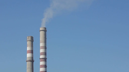 Industrial smokestacks against the blue sky Stock Video Footage
