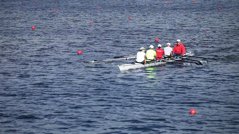 Sculling four men rowing Live Action