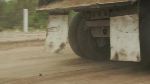 Dump Truck Dirt Road Fast Pan stock footage