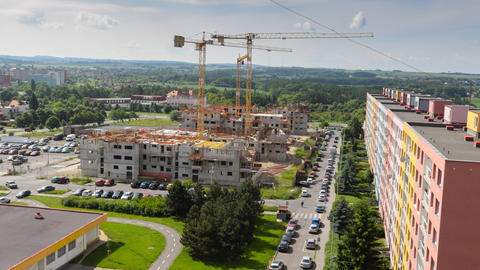 4k UHD housebuilding construction wide pan 11406 Stock Video Footage