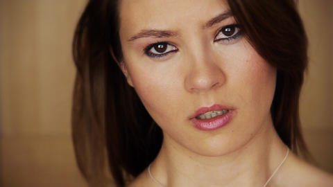 Sad young woman grymacing Footage
