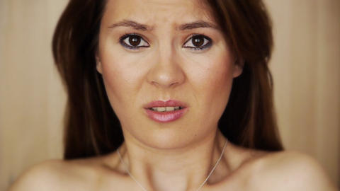 Scared young woman grimacing Stock Video Footage