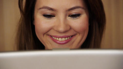 Smiling young woman using laptop Footage