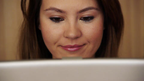 Smiling young woman using laptop Stock Video Footage