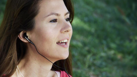 Young woman singing in park Stock Video Footage