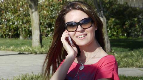 Girl phone talking park smile Footage
