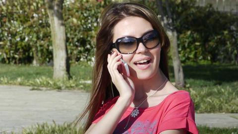 Girl phone talking park smile Stock Video Footage