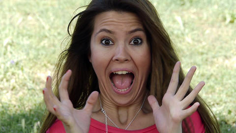 Young woman screaming in surprise Stock Video Footage