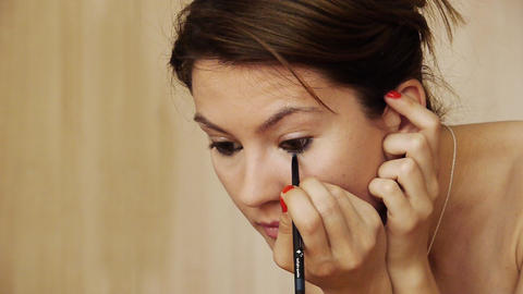 Beautiful girl makeup eyeliner Stock Video Footage