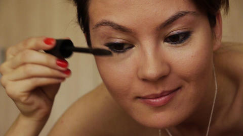 Beautiful girl makeup mascara smile Footage