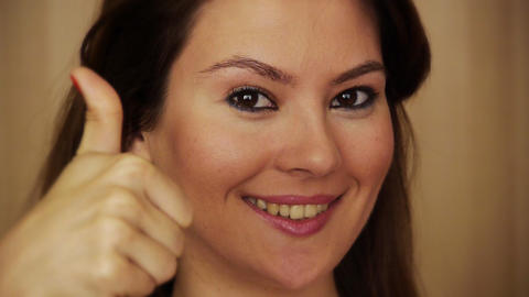 Young woman smiling with thrumbs up Stock Video Footage