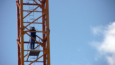 crane-operator rises on crane Stock Video Footage