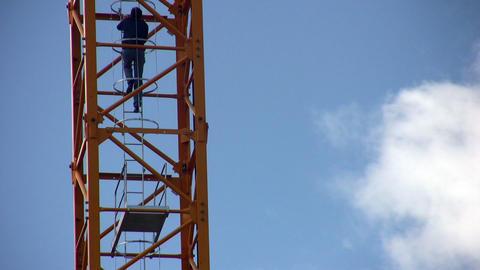 crane-operator rises on crane Stock Video Footage