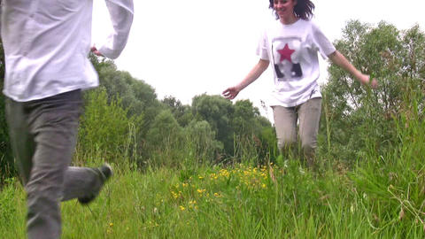 walking friends on grass Stock Video Footage