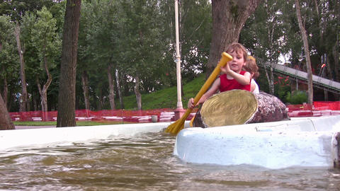 children on attraction boat Stock Video Footage